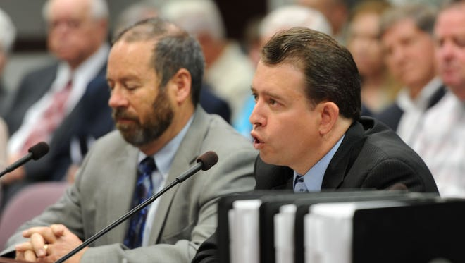 Washoe County School Superintendent Pedro Martinez, right, testifies in 2013 at the Nevada Legislature.