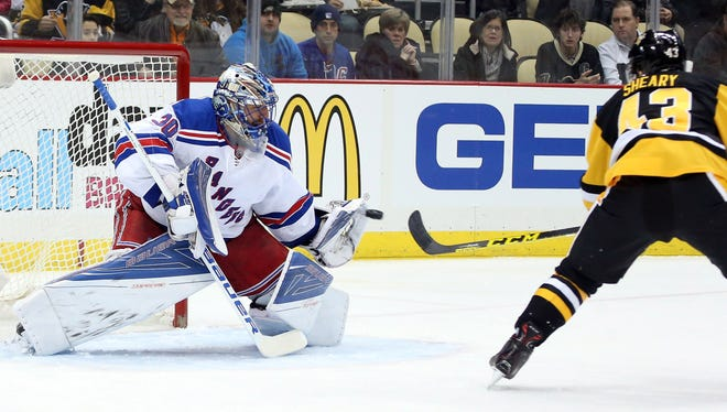 Rangers goalie Henrik Lundqvist makes a glove save against Penguins left wing Conor Sheary during the second period at the CONSOL Energy Center.