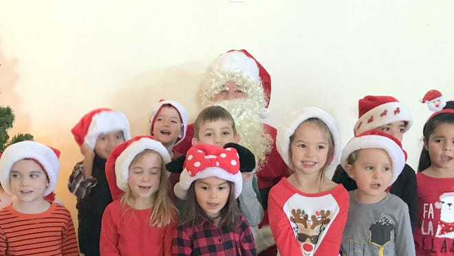 Students at Fruit of the Vine preschool shared their Christmas gift lists with a special visitor to the school this past week. The students were surprised by Santa Claus and were able to spend time with Jolly St. Nick and detail what they might expect under the Christmas tree. Fruit of the Vine is located at the Holy Family Catholic Church Parish Center at 615 S. Copper Street.