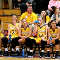 From left: Kickapoo sophomores Audrey Warren (31), Jordan Wersinger and Hannah Collins (13) take a breather during Kickapoo's 76-27 win at Glendale Monday, Feb. 8.