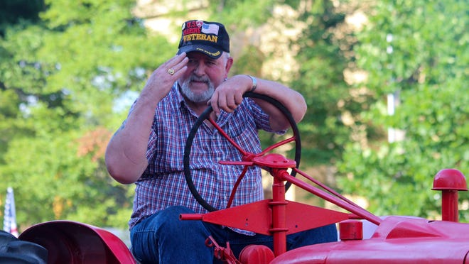 Don Denning of the Center Adams Tractor Club salutes a fellow veteran in the crowd during Hillsdale's American Patriot Parade on Friday, July 3. Sam Fry/Daily News