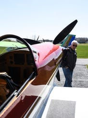 Ron Snyder of Bernville looks at his F1 Rocket at Farmers