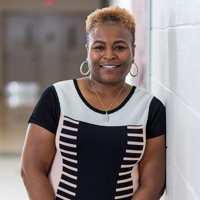 Wilmington educator favors professional, but trendy attire