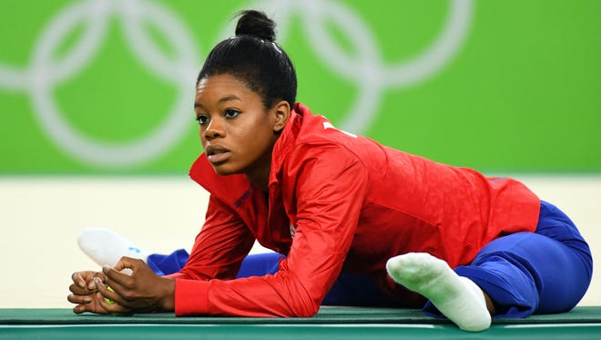 Gabby Douglas won a team gold in gymnastics but did not really enjoy her time in Rio because of social media criticism.