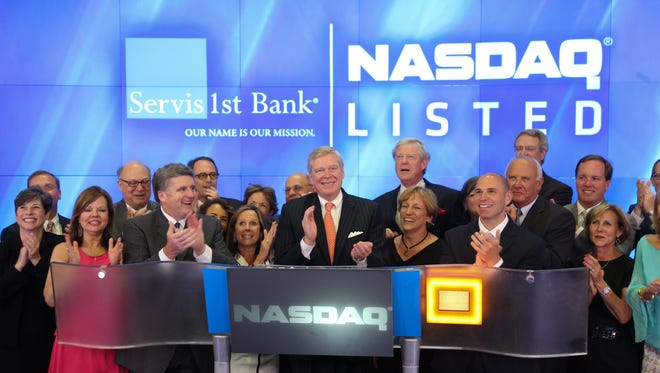 ServisFirst Bank executives ring the closing bell for the NASDAQ on June 26.