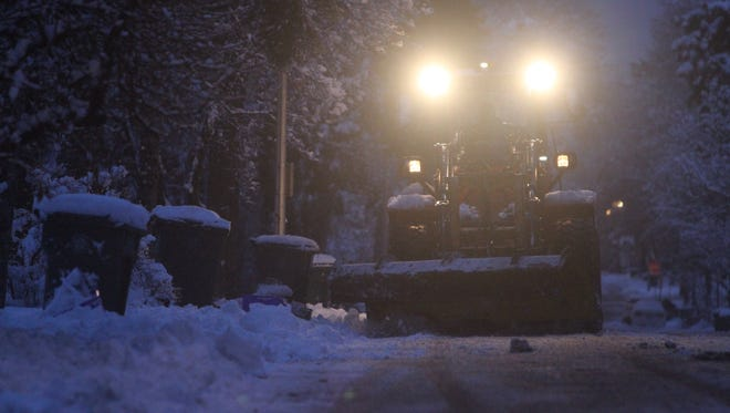 A plow makes its way down Corwin Road in Rochester Wednesday.