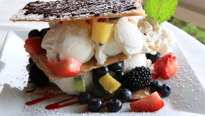 The Ice Cream Sandwich; layers of sweet crispy phyllo pastry, fresh fruit and vanilla ice cream with whipped cream, chocolate and raspberry sauces, is photographed at Half Moon, a casual American restaurant, July 20, 2012 in Dobbs Ferry.