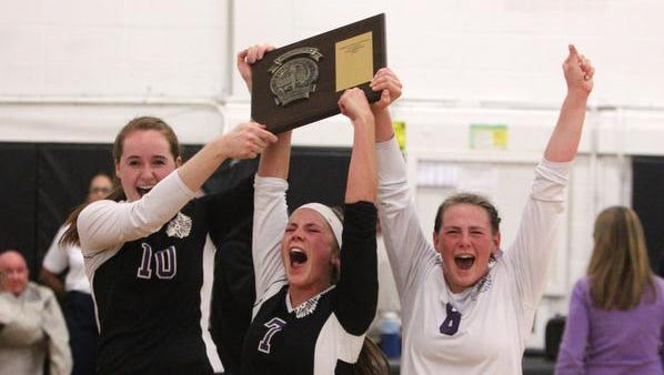 John Jay's Elish Newcomb, left, Amanda Flayhan and Theresa Swertfager celebrate after John Jay beat Yorktown in the Class A Section 1 volleyball final at Croton-Harmon Saturday.