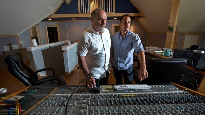 Russ Zavitson and Eric Hurt look over the soundboard at the former home and studio of Cowboy Jack Clement. Zavitson Music Group purchased the property but is waiting for a zoning issue to be resolved before using it.