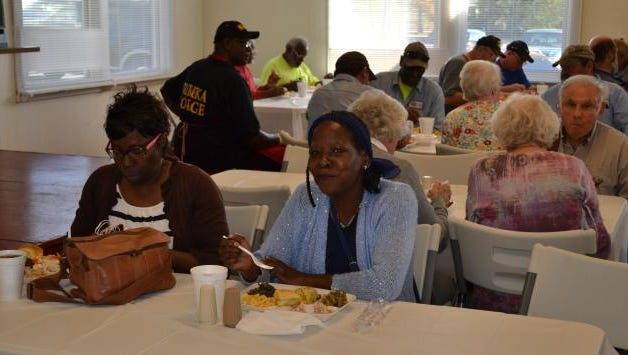 Here, several of the folk that attended to receive a free, home-cooked meal are pictured including Jackie Brown.