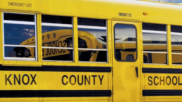 Four Knox County school bus drivers are facing criminal charges for using an electronic device while on the job.