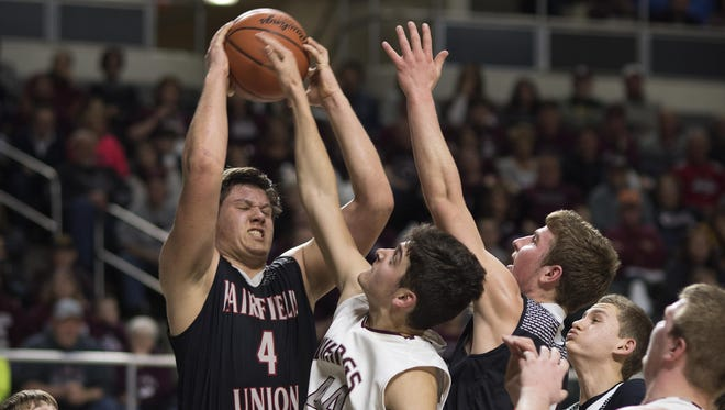 Fairfield Union junior Colin Woodside grabs a rebound during last year's district final game. Woodside helped lead the Falcons to their first league title in 20 years.