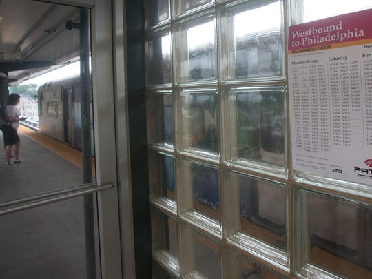 Paper timetables of PATCO train schedule are shown