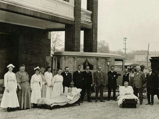 Mansfield General Hospital employees pose for a photo with the hospital's first patients on May 21, 1918.