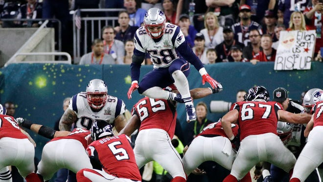 The Patriots' Shea McClellin leaps over the line of scrimmage in an attempt to block a kick during the first half of Super Bowl LI  in Houston on Feb. 5, 2017