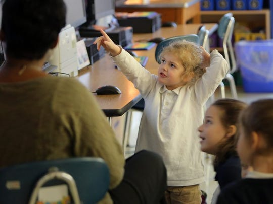 Then-second grader Kate Wyatt answers a science question during class at the University of Memphis Campus School in January 2016.