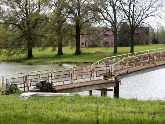 The bridge shown is a focal point across the lake on the Circle G Ranch in Horn Lake. (Stan Carroll/The Commercial Appeal)
