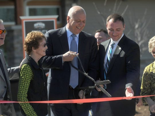 Major League Baseball Hall of Famer Cal Ripken Jr. cuts the ribbon to officially open the Ripken Experience Youth Baseball Complex in Pigeon Forge.