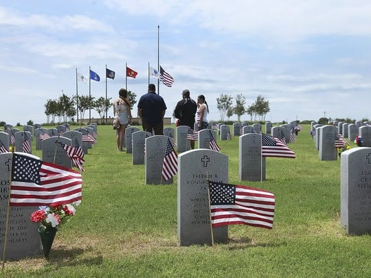 GEORGE TULEY/SPECIAL TO THE CALLER-TIMES Families gathered to pay their respects on Memorial Day at the Coastal Bend State Veterans Cemetery in Corpus Christi on Monday, May 30, 2016.