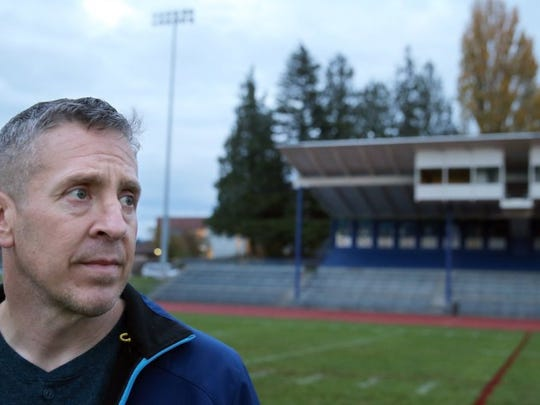Former Bremerton High School assistant football coach Joe Kennedy at Bremerton Memorial Stadium last year. Kennedy is suing the Bremerton School District after he was fired for refusing to stop praying at midfield following football games. (LARRY STEAGALL / KITSAP SUN FILE)