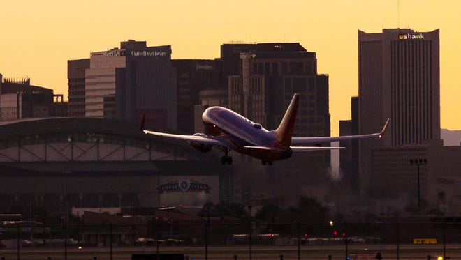 A plane takes off from Phoenix Sky Harbor Airport towards downtown Phoenix August 5, 2015.