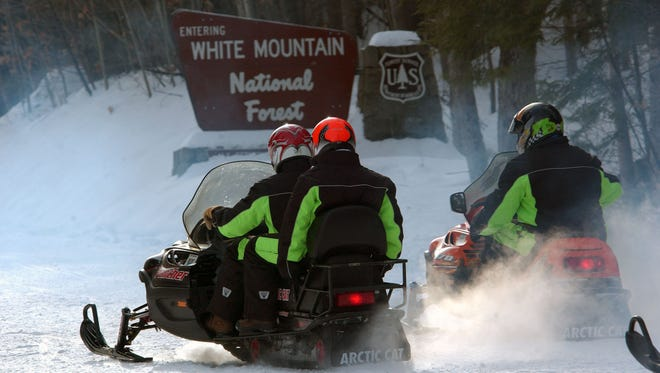 In this Dec. 28, 2005, file photo, a group of snowmobilers start their travels on Bear Notch Road in Bartlett, N.H.