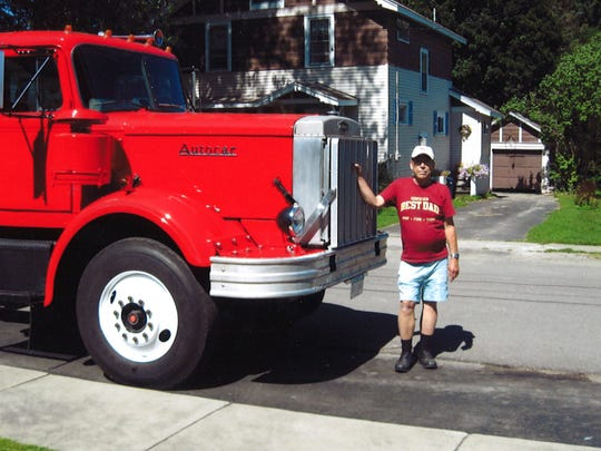 Paul Purple with an Autocar truck he refurbished himself in his garage.