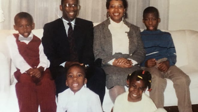 Ebony Barrett-Kennedy, bottom right, posed with her family in this 1989 photo, clockwise from top left: her brother Courtney; father Paul Wm. Barrett Sr.; mother; Kerry; brother, Paul Jr.; and brother, David.