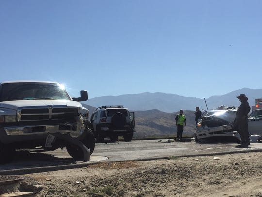 Damaged vehicles block Ramon Road near Landau Boulevard. Several people were injured in the collision, which happened on the Palm Springs-Cathedral City border, police say.