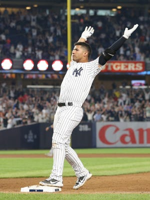 New York Yankees second baseman Gleyber Torres celebrates after hitting the game winning RBI single against the Houston Astros during the tenth inning at Yankee Stadium.