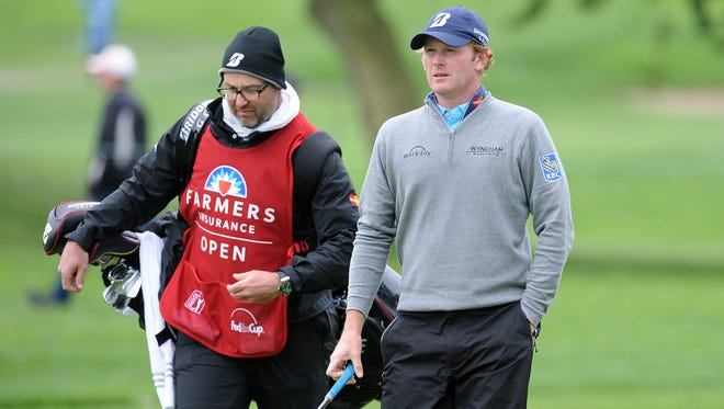 Brandt Snedeker walks with caddie Scott Vail on the 15th fairway during the final round of the Farmers Insurance Open on Sunday.