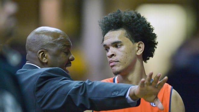 Jan 12, 2016; Nashville, TN, USA; Auburn Tigers associate head coach Chuck Person talks with Auburn Tigers forward Tyler Harris (12) during the second half at Memorial Gym. Vanderbilt won 75-57. Mandatory Credit: Jim Brown-USA TODAY Sports