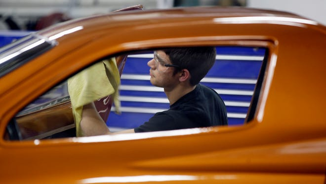 Lakeshore Technical College student Tom Malone of Cascade dries off a vehicle that was washed prior to presentation to the customer.