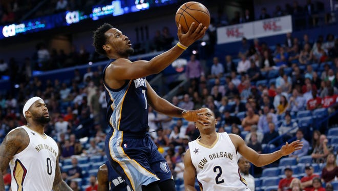 Memphis Grizzlies guard Wayne Selden (7) drives to the basket between New Orleans Pelicans forward DeMarcus Cousins (0) and guard Tim Frazier (2) in the first half of an NBA basketball game in New Orleans, Tuesday, March 21, 2017. (AP Photo/Gerald Herbert)
