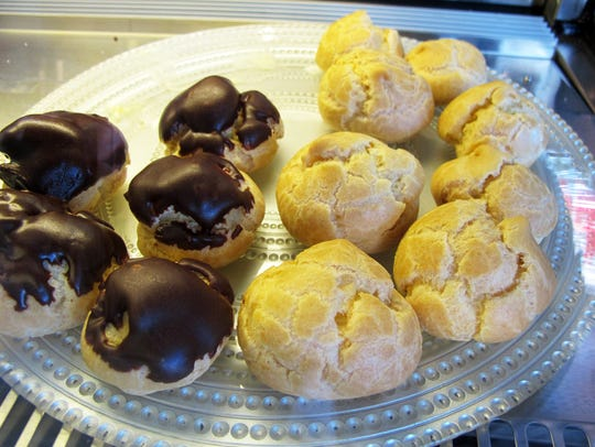 Dessert options include cream puffs, cannoli and cheesecake
