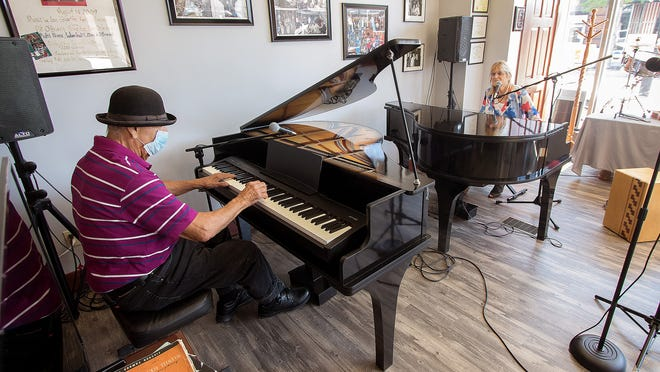 """Little Joe,"" left, and The Music Store owner Jan Cox, right, perform during a dueling pianos program Aug. 8 at the downtown Salem store as part of the 2020 Freed Fest. The event honored Alan Freed, an influential disc jockey during the early years of Rock and Roll."