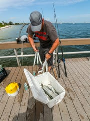 Jesse Warner puts his Spanish mackerel back in his cooler after cleaning things off. He said fishing is still good from the Sanibel fishing pier, but if it slows he will start to take his kayak out into deeper waters away from the brown water. The brown water is back and it's covering parts of Fort Myers Beach and Sanibel thanks to the Lake O releases. The fishermen and locals aren't happy about it, but on Sunday the brown water wasn't stopping beach goers, most of them from out of town, from enjoying the water.