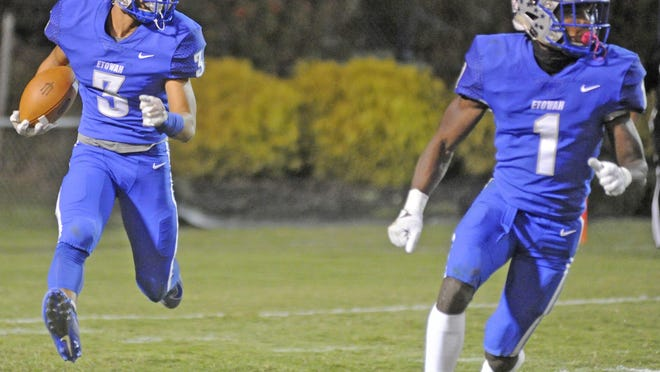 Etowah's Trent Davis, left, runs the ball as NyNy Davis leads the way against Alexandria during a high school football game at Jim Glover Stadium in Attalla on Oct. 18.