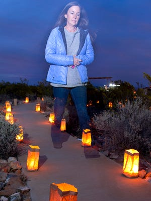 Visitors to the  Chihuahuan Desert Nature Park Friday night got a chance to stroll through luminaria lit paths. sip hot chocolate, roast marshmallows and even sing Christmas carols.