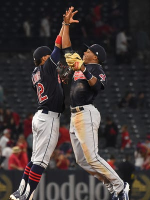 Francisco Lindor and Greg Allen high five after the final out.