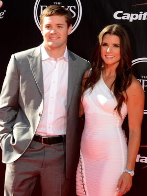 Jul 16, 2014; Los Angeles, CA, USA;  Race car drivers Danica Patrick (right) and Ricky Stenhouse Jr. arrive at the 2014 ESPY Award show at Nokia Theatre.