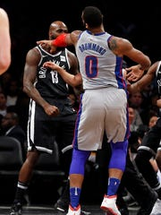 Pistons center Andre Drummond shoves Nets forward Quincy
