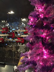 A small signature purple Christmas tree greets guests at the check-in counter at the Hard Rock Hotel Palm Springs.