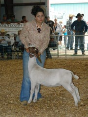 A teenager shows her goat during the Lincoln County