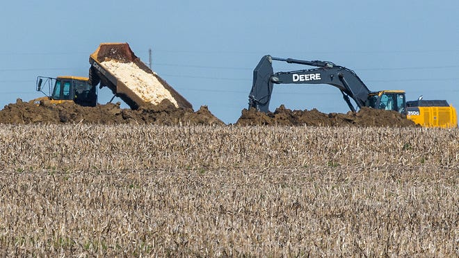 Dead chickens are buried in a farm field near Rose Acre Farms, just west of Winterset, on May 12. Rose Acre Farms destroyed about 1.5 million birds after the avian influenza virus was discovered.