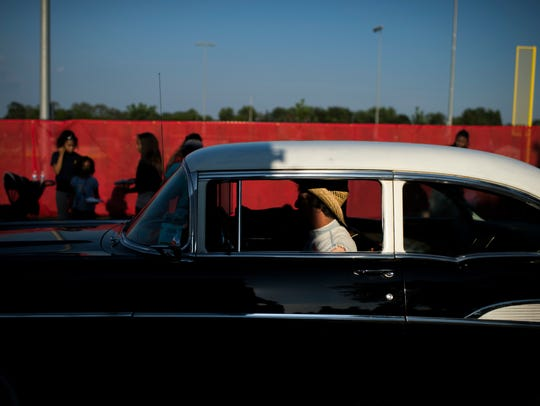 A man in a Chevy Bel Air makes his way to the car show