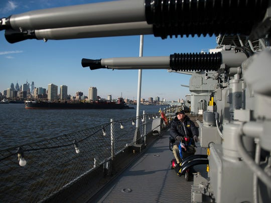 Navy veteran Paul Niessner gets a closer look at a restored 40mm anti-aircraft gun as a ceremony is held commemorating the 75th anniversary of the USS New Jersey's launch Thursday, Dec. 7, 2017 in Camden.