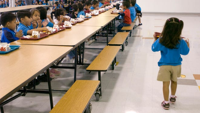 Students eat lunch at C.L. Taitano Elementary School's cafeteria. Pacific Daily News file photo