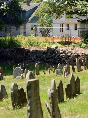 No human bones were found behind any of the three homes to be razed for a Burger King in Norwichtown that is next to the Old Norwichtown Burying Ground.