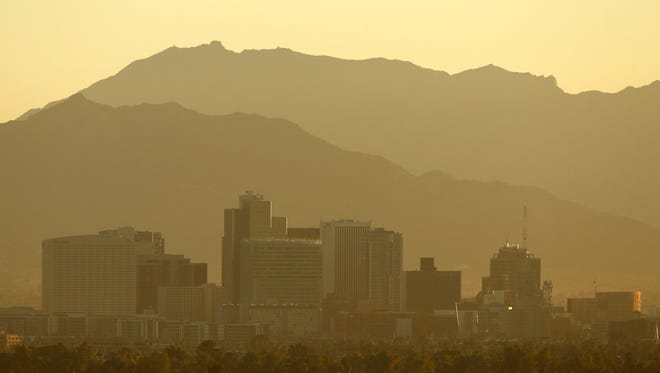 Smog and haze dulls the Phoenix skyline on Wednesday, Jan. 15, 2014 in Phoenix.